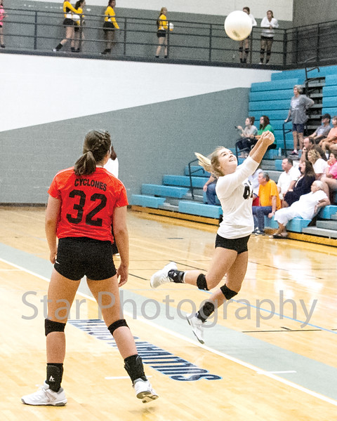 Star Photo/Larry N. Souders<br /> The Lady Cyclone's Mary Beth Biggs (42) leaps to return a serve from Sullivan East.