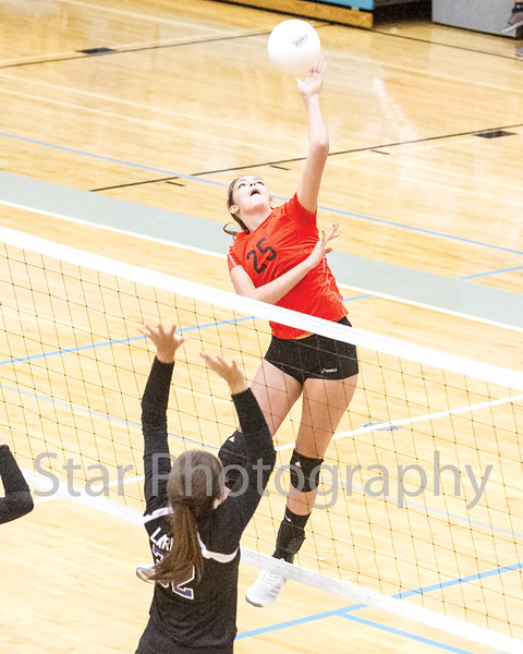 Star Photo/Larry N. Souders<br /> The Lady Cyclone's Hannah Booster (25) sky's for another spike against the Lady Blue Devil's of Unicoi.