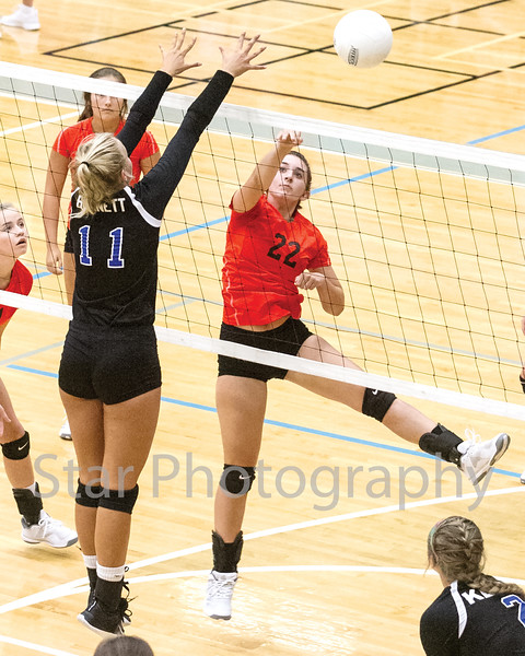 Star Photo/Larry N. Souders<br /> Elizabethton's Macey Burleson (22) drives a spike around the block attempt by Katelyn Bennett (11) of Unicoi.