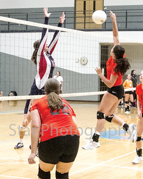 Star Photo/Larry N. Souders<br /> In their second match of the night Elizabethton's Cassidee Smith (7) drives a kill shot through the arms of a Lady Patriot's defender.