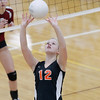 Record-Eagle/Jan-Michael Stump<br /> Houghton's Linnea Dunstan (12) sets the ball in Tuesday's Class C quarterfinals match at Charlevoix.