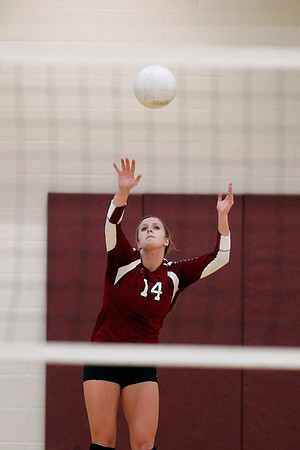 Record-Eagle/Jan-Michael Stump<br /> Charlevoix's Jenna Way (14) serves in the first game of Tuesday's win over Houghton in the Class C quarterfinals.