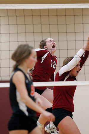 Record-Eagle/Jan-Michael Stump<br /> Charlevoix's Megan Peters (12) and Kelsey Way (7) celebrate a point during Tuesday's win over Houghton in the Class C quarterfinals in Charlevoix.