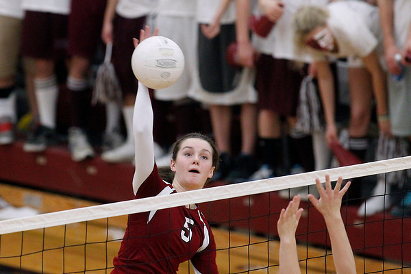 Record-Eagle/Jan-Michael Stump<br /> Charlevoix's Madeline Boss (5) spikes the ball at Houghton in the Class C quarterfinals Tuesday in Charlevoix.