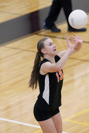 Record-Eagle/Jan-Michael Stump<br />  Houghton's Taylor Dillinger (13) sets the ball in Tuesday's Class C quarterfinals match at Charlevoix.