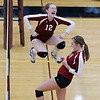 Record-Eagle/Jan-Michael Stump<br /> Charlevoix's Megan Peters (12) and Jenna Way (14) celebrate a point against Houghton in the Class C quarterfinals Tuesday in Charlevoix.
