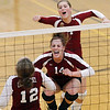 Record-Eagle/Jan-Michael Stump<br /> Charlevoix's Megan Peters (12), Jenna Way (14) and KElsey Way (7) celebrate a point against Houghton in the Class C quarterfinals Tuesday in Charlevoix.