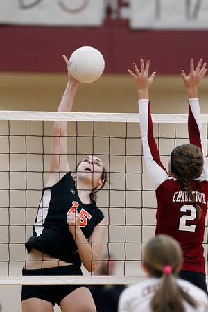 Record-Eagle/Jan-Michael Stump<br />  Houghton's Joey Carroll (15) spikes the ball at Charlevoix's Anna Way (2) in the Class C quarterfinals Tuesday in Charlevoix.