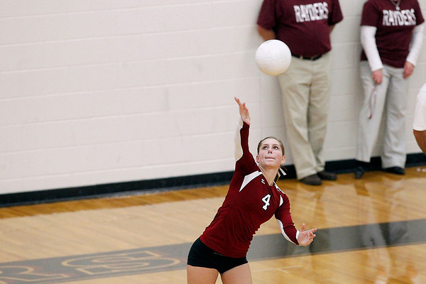 Record-Eagle/Jan-Michael Stump<br /> Charlevoix's Chelsie Hoffman (4) serves to Houghton in the Class C quarterfinals Tuesday in Charlevoix.