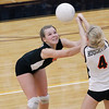 Record-Eagle/Jan-Michael Stump<br /> Houghton's Genevieve Flaspohler (3) and Abbey Fenton (4) try to bump the ball in Tuesday's Class C quarterfinals loss at Charlevoix.
