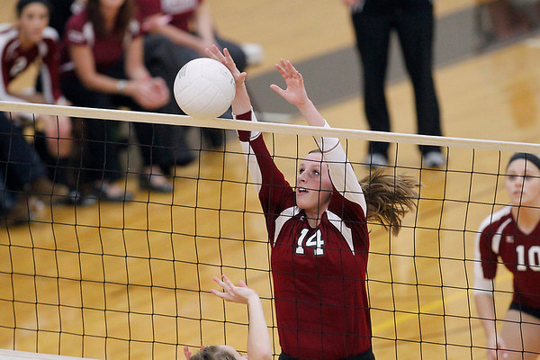 Record-Eagle/Jan-Michael Stump<br /> Charlevoix's Jenna Way (14) blocks a shot by Houghton in the Class C quarterfinals Tuesday in Charlevoix.