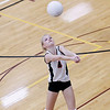 Record-Eagle/Jan-Michael Stump<br />  Houghton's Abby Fenton (4) bumps the ball in Tuesday's Class C quarterfinals match at Charlevoix.