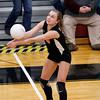 Record-Eagle/Jan-Michael Stump<br /> Houghton's Genevieve Flaspohler (3) bumps the ball in Tuesday's Class C quarterfinals Tuesday at Charlevoix.