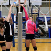 Record-Eagle/Jan-Michael Stump<br /> East Jordan's Paige Poindexter (11) tries to block a tip by Traverse City St. Francis' Kaitlyn Hegewald (9)