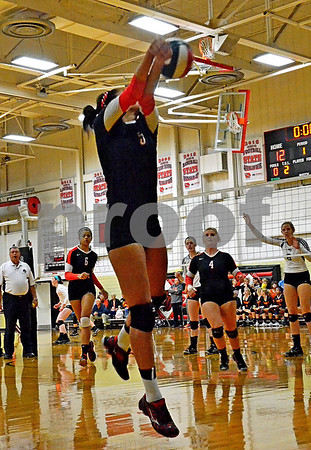 -Messenger photo by Britt Kudla<br /> Ashley Altman of Fort Dodge makes a diving save during Saturday's Jackie Wilde Volleball invitational against Ankeny