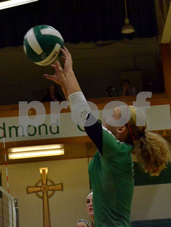 -Messenger photo by Britt Kudla<br /> Jaci Stumpf of St. Edmond sets for teammate Alli Huss on Thursday against Iowa Fall