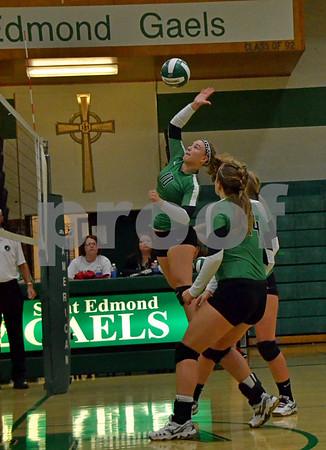 -Messenger photo by Britt Kudla<br /> Anna Yung of St. Edmond spikes the ball against Iowa Fall on Thursday night