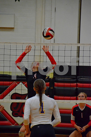 -Messenger photo by Britt Kudla<br /> Maci Knutson of Fort Dodge blocks a shot against Waukee during Tuesday night game at Fort Dodge High School