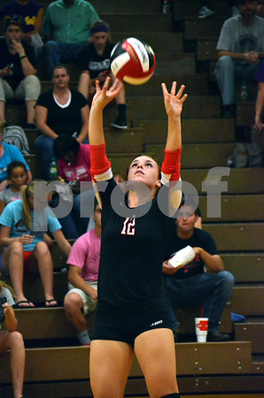 -Messenger photo by Britt Kudla<br /> Madison Egli of Fort Dodge sets the ball in play during Tuesday's game against Waukee