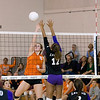 Record-Eagle/Keith King<br /> Kingsley's Emily Fasel hits the ball as Leland's Felicia Whittaker, right, jumps to try and block the ball Tuesday, October 11, 2011 at Leland High School.
