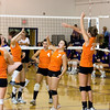 Record-Eagle/Keith King<br /> Kingsley's Danielle Fulker, second from right, and Anne-Marie Sanchez, third from right, celebrate with their teammates after scoring a point against Leland Tuesday, October 11, 2011 at Leland High School.