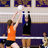 Record-Eagle/Keith King<br /> Leland's Andrea Hunt, right, jumps to try and block a shot from Kingsley's Emily Fasel Tuesday, October 11, 2011 at Leland High School.
