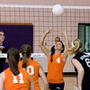 Record-Eagle/Keith King<br /> Kingsley's Anne-Marie Sanchez sets the ball as Leland's Elizabeth McKee, left, readies herself Tuesday, October 11, 2011 at Leland High School.