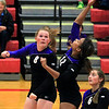 Record-Eagle/Jan-Michael Stump<br /> Leland's Felicia Whittaker (12) spikes the ball while teammates Samantha Sterkenburg (8) and Caitlyn McKee (6) watch in Monday's win over Forest Area.