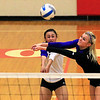 Record-Eagle/Jan-Michael Stump<br /> Leland's Maggie Osorio (3) and Andrea Hunt (5) collide while reaching for a serve in Monday's win over Forest Area.