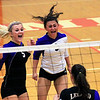 Record-Eagle/Jan-Michael Stump<br /> Leland's Andrea Hunt (5) and Maggie Osorio (3) celebrate during the second game of Monday's win over Forest Area.