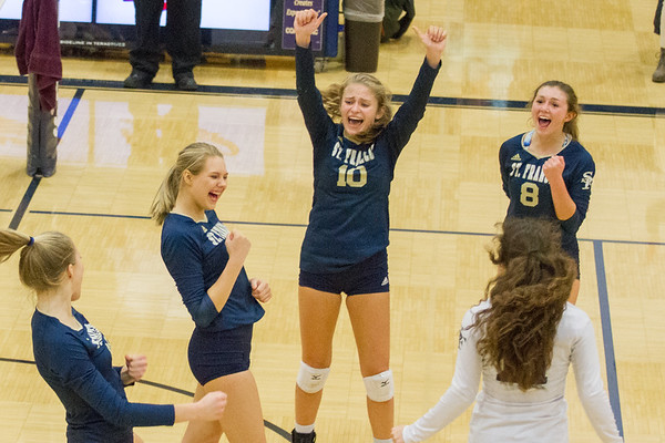 Record-Eagle/Brett A. Sommers Traverse City St. Francis' Kaylin  Poole (left), Brenna Poole, Hannah Sidorowicz (10), Maddie Connolly (8) and Ashlynn Coger (right) celebrate a point scored during Tuesday's Division 3 quarterfinal volleyball match against Beal City at Cadillac High School. St. Francis won 3-1.