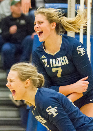 Record-Eagle/Brett A. Sommers Traverse City St. Francis' Brenna Molly Mirabelli (7) and Brenna Poole celebrate winning Tuesday's Division 3 quarterfinal volleyball match against Beal City at Cadillac High School. St. Francis won 3-1.