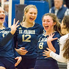 Record-Eagle/Brett A. Sommers Traverse City St. Francis' Maddie Connolly (8) reacts with teammates Kaylin Poole (left), Brenna Poole (12) and Ashlynn Coger (right) after a string of kills during Tuesday's Division 3 quarterfinal volleyball match against Beal City at Cadillac High School. St. Francis won 3-1.
