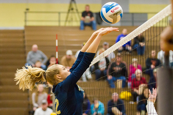 Record-Eagle/Brett A. Sommers Traverse City St. Francis' Brenna Poole rejects a Rogers City attack during Tuesday's regional semifinal volleyball game in Gaylord. St. Francis won 3-1.