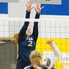 Record-Eagle/Brett A. Sommers Traverse City St. Francis' Lauren Tocco (2) attempts to block the attack of Rogers City's Catherine Hart during Tuesday's regional semifinal volleyball game in Gaylord. St. Francis won 3-1.