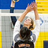 Record-Eagle/Brett A. Sommers Traverse City St. Francis' Molly Mirabelli sends an attack at Rogers City's Taylor Fleming (4) during Tuesday's regional semifinal volleyball game in Gaylord. St. Francis won 3-1.