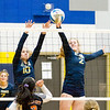 Record-Eagle/Brett A. Sommers Traverse City St. Francis' Hannah Sidorowicz (10) and Lauren Tocco (2) block Rogers City's attack during Tuesday's regional semifinal volleyball game in Gaylord. St. Francis won 3-1.
