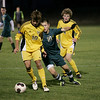 Record-Eagle/Keith King<br /> Traverse City Central's Parker Hogarth, left, is tries to control the ball against Traverse City West's Matt Phillips as Traverse City Central's Taylor Cook, back, looks on Tuesday, October 18, 2011.