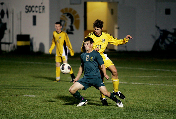 Record-Eagle/Keith King<br /> Traverse City West's Marshall Cartwright, left, tries to control the ball against Traverse City Central's Brandon Busuttil Tuesday, October 18, 2011.