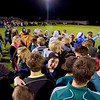 Record-Eagle/Keith King<br /> Traverse City West fans run onto the field to congratulate Traverse City West soccer players after they defeated Traverse City Central Tuesday, October 18, 2011 in Traverse City.