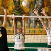 Record-Eagle photo/Jan-Michael Stump<br /> Traverse City Central's Taylor Besneatte (5) tries to spike the ball over Traverse City West's Paige Johns (1) and Tayler Rodes (11) Tuesday night.