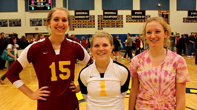 Broad Run seniors Elisa Scudder (No. 15), Lizzie Deane (No. 1) and Carolyn Pearce after the Spartans knocked off Loudoun County Saturday in the AA Dulles District volleyball tournament finals.