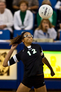Dublin Coffman High School's #12 Isolde Hannan spikes the ball against Mount Notre Dame High Schools Volleyball team during their match-up in the OHSAA Division I Regional Volleyball Tournament held Saturday afternoon November 7, 2009 at the Hilliard Davidson HIgh School. Dublin won the tournament 3 games to 1. (© James D. DeCamp | http://www.JamesDeCamp.com | 614-367-6366)