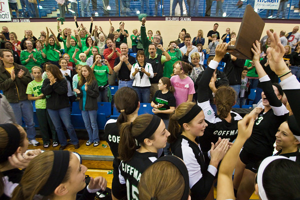 Dublin Coffman High School's Volleyball Team celebrates their victory against Mount Notre Dame High Schools Volleyball team during their match-up in the OHSAA Division I Regional Volleyball Tournament held Saturday afternoon November 7, 2009 at the Hilliard Davidson HIgh School. Dublin won the tournament 3 games to 1. (© James D. DeCamp | http://www.JamesDeCamp.com | 614-367-6366)