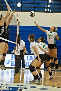 Newark Catholic High School's #1 Jayla Graves reaches for the ball against Bishop Ready High School in their match-up in the Ohio High School Athletic Associations' 2010 Division III Central District Semifinal volleyball game held at Hilliard Bradley High School Wednesday night October 27, 2010.  (©2010 James D. DeCamp / http://www.OhioPhotojournalist.com / 614•462•8027)