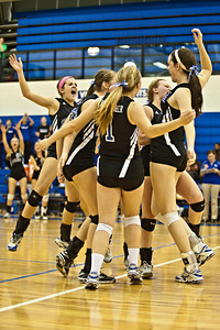 Bishop Ready High School's volleyball team reacts to a point scored in their game against Newark Catholic High School in the Ohio High School Athletic Associations' 2010 Division III Central District Semifinal volleyball game held at Hilliard Bradley High School Wednesday night October 27, 2010.  (©2010 James D. DeCamp / http://www.OhioPhotojournalist.com / 614•462•8027)