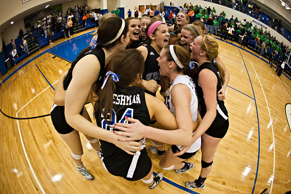 Bishop Ready High School's volleyball team celebrates their win against Newark Catholic High School in their match-up in the Ohio High School Athletic Associations' 2010 Division III Central District Semifinal volleyball game held at Hilliard Bradley High School Wednesday night October 27, 2010.  (©2010 James D. DeCamp / http://www.OhioPhotojournalist.com / 614•462•8027)