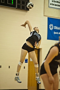 Bishop Ready High School's #12 Erin Sekinger serves the ball in her game against Newark Catholic High School in the Ohio High School Athletic Associations' 2010 Division III Central District Semifinal volleyball game held at Hilliard Bradley High School Wednesday night October 27, 2010.  (©2010 James D. DeCamp / http://www.OhioPhotojournalist.com / 614•462•8027)