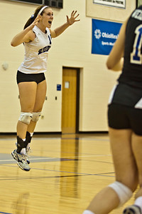 Bishop Ready High School's #15 Lindsey Kusann reacts to a point scored in her game against Newark Catholic High School in the Ohio High School Athletic Associations' 2010 Division III Central District Semifinal volleyball game held at Hilliard Bradley High School Wednesday night October 27, 2010.  (©2010 James D. DeCamp / http://www.OhioPhotojournalist.com / 614•462•8027)