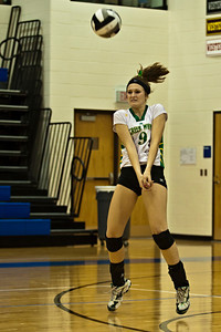 Newark Catholic High School's #9 Abbi Morrow sets the ball against Bishop Ready High School in their match-up in the Ohio High School Athletic Associations' 2010 Division III Central District Semifinal volleyball game held at Hilliard Bradley High School Wednesday night October 27, 2010.  (©2010 James D. DeCamp / http://www.OhioPhotojournalist.com / 614•462•8027)